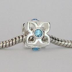 Blomst med blå sten