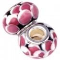 Glas charm med lyserøde prikker på sort bund